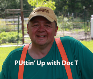 Doc T with Title over chest - Logo